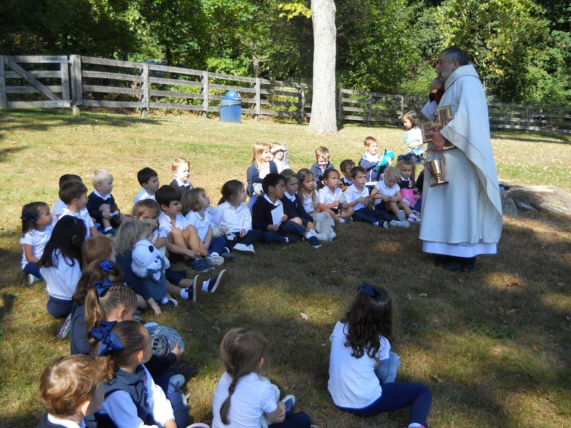 """Father Murphy Visits PreK for """"Blessing of the Animals"""" Thumbnail Image"""