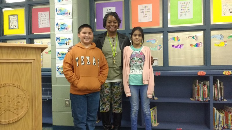 Mrs. Good with our first and second place spellers: Devan and Kimberly