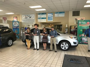 Teacher of the Year from Avery, McDowell, Mitchell and Yancey county in front of new car