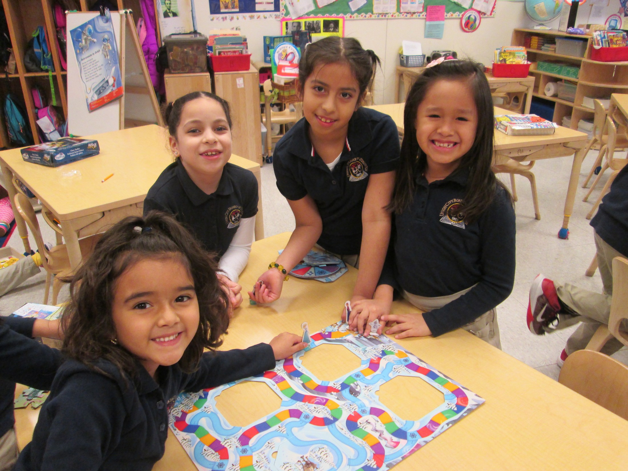 girls playing a board game together