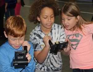 Picture, Students using AR hardware and software.