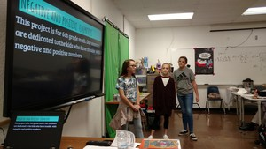 SMS Students present to Shark Tank Judges trying to achieve a high score