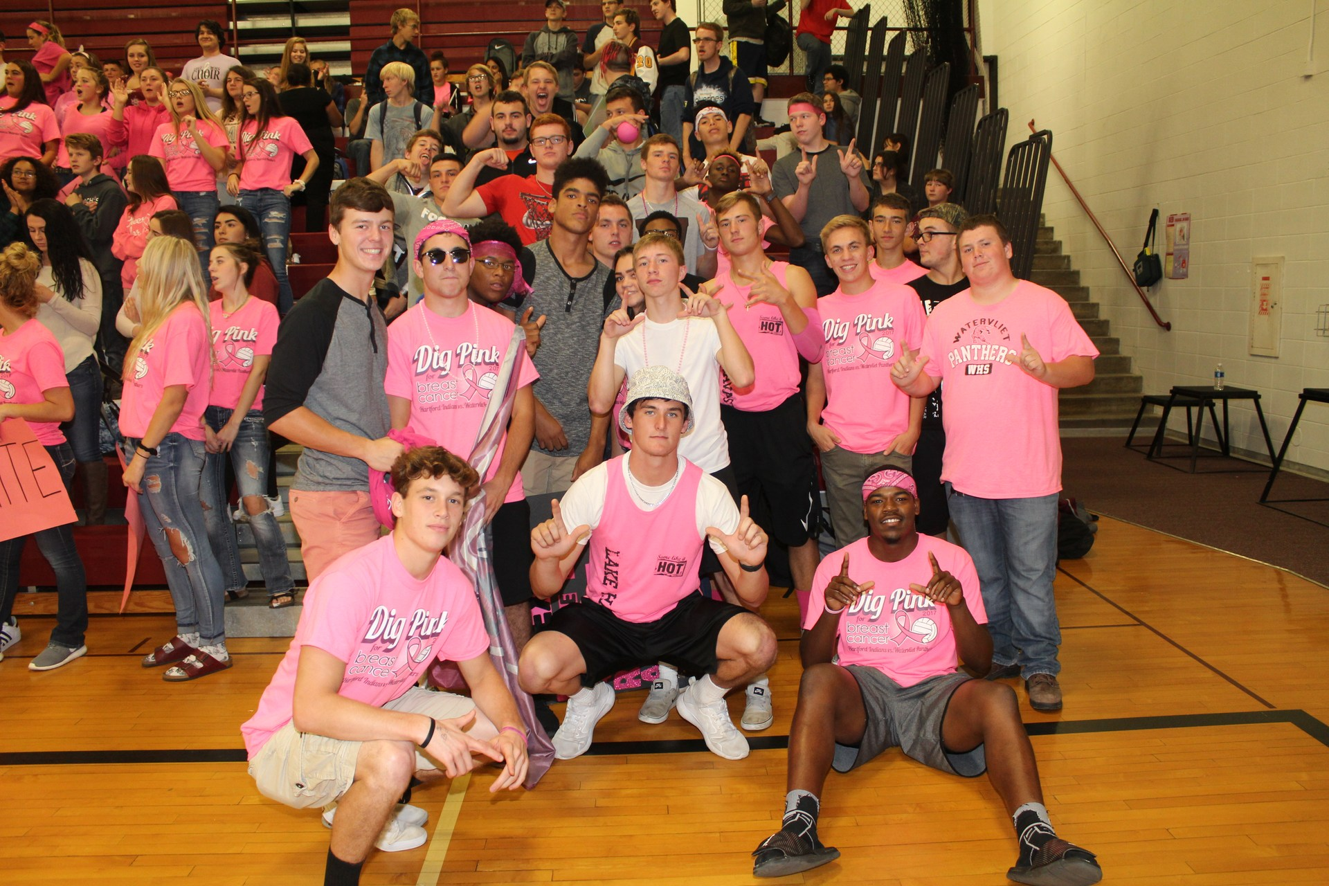 students posing at Pink Volleyball game