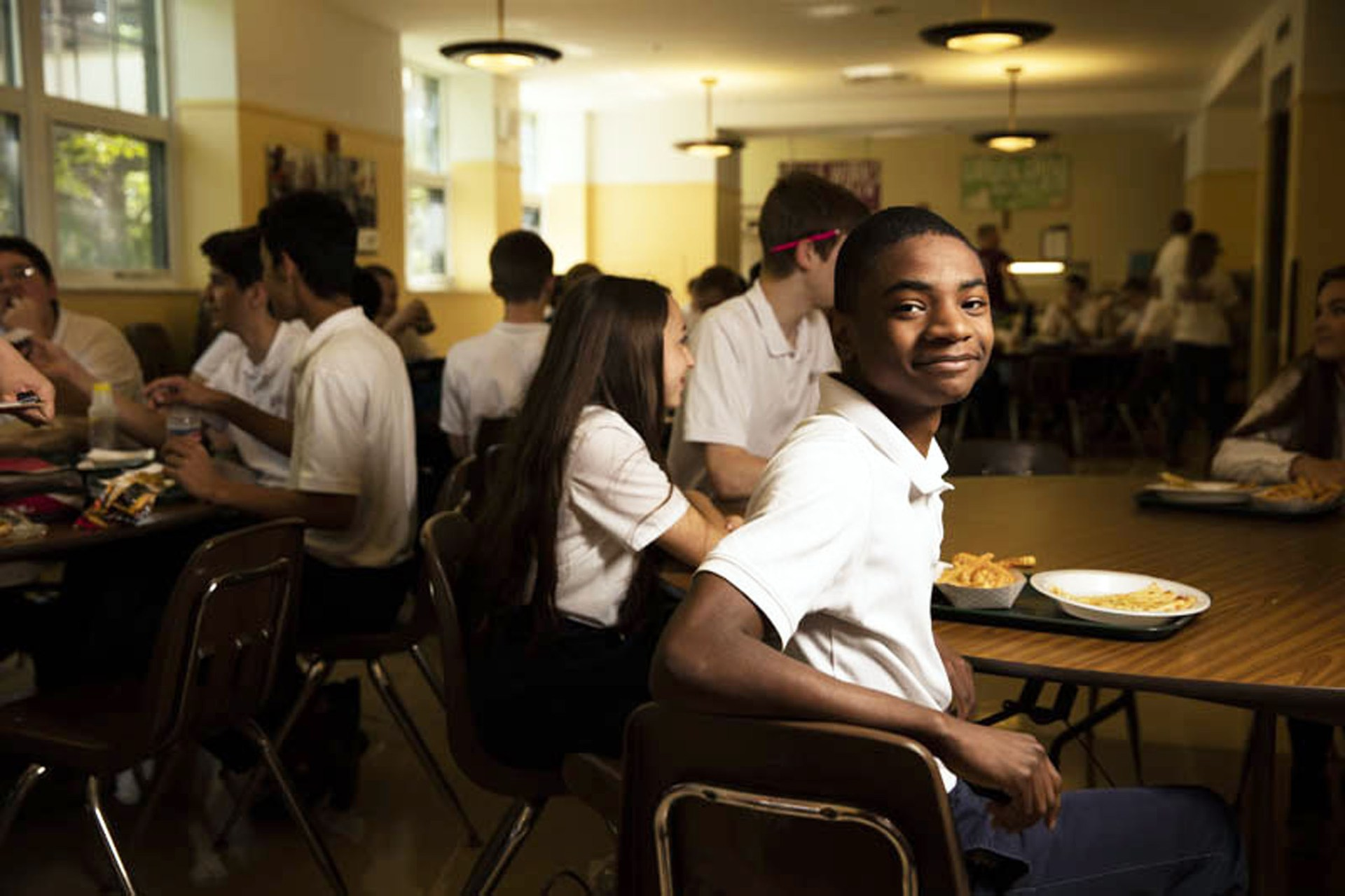 A student enjoys lunch in the OLSH cafeteria