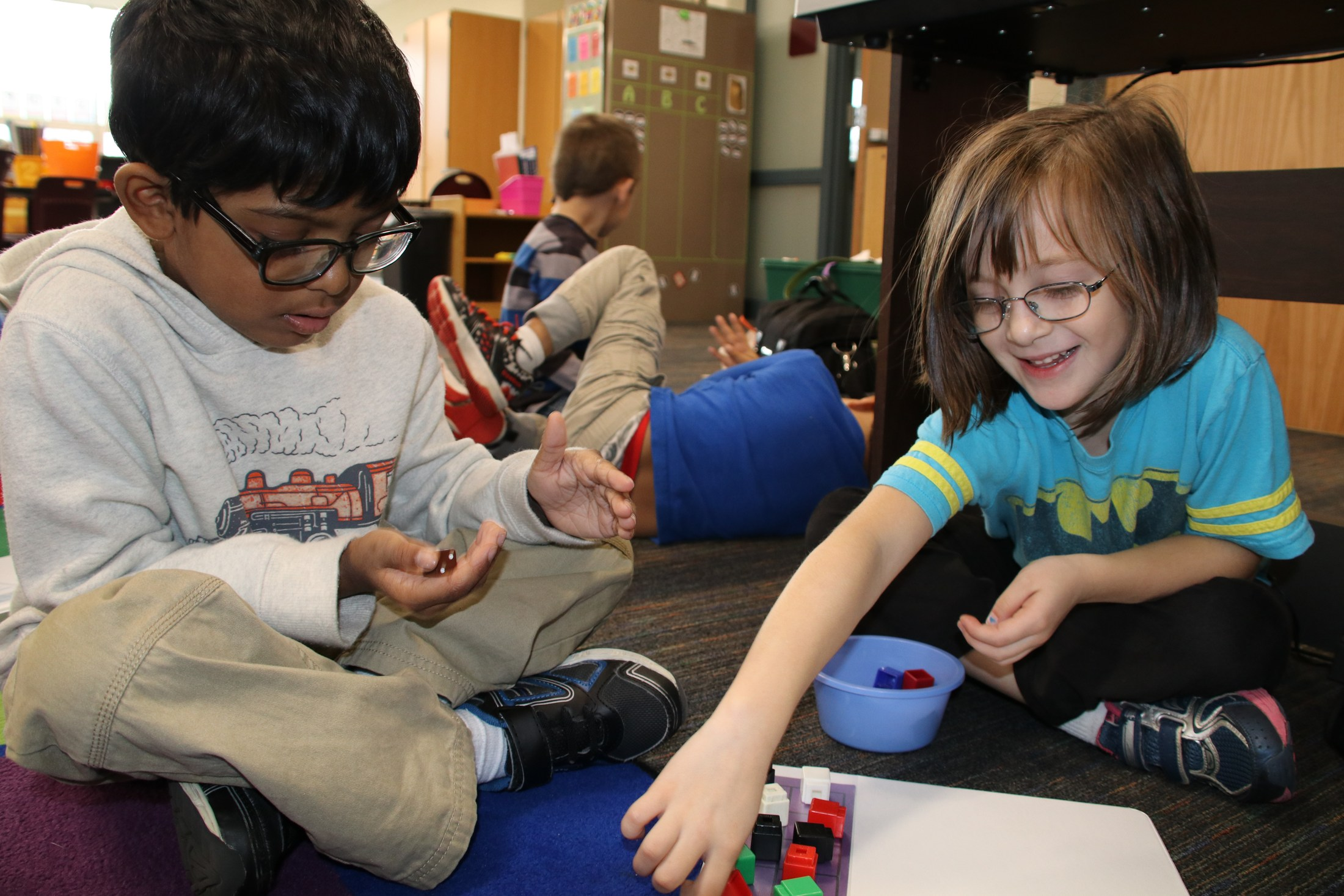 two kindergarten students play math dice game