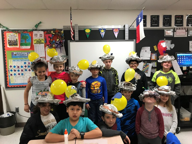 made hats out of newspaper and craft supplies to represent soil, sunlight, water, and nutrients
