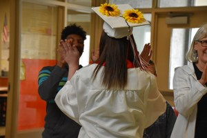 EVHS senior giving a high-five to a special ed student.