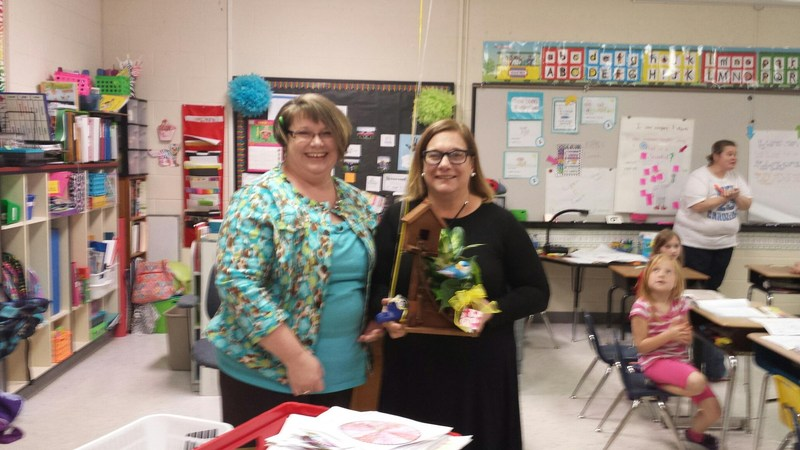 Instructional Assistant Teacher of the year with certificate.