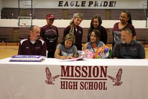 group picture of Iveth, family, and coaches at the signing.