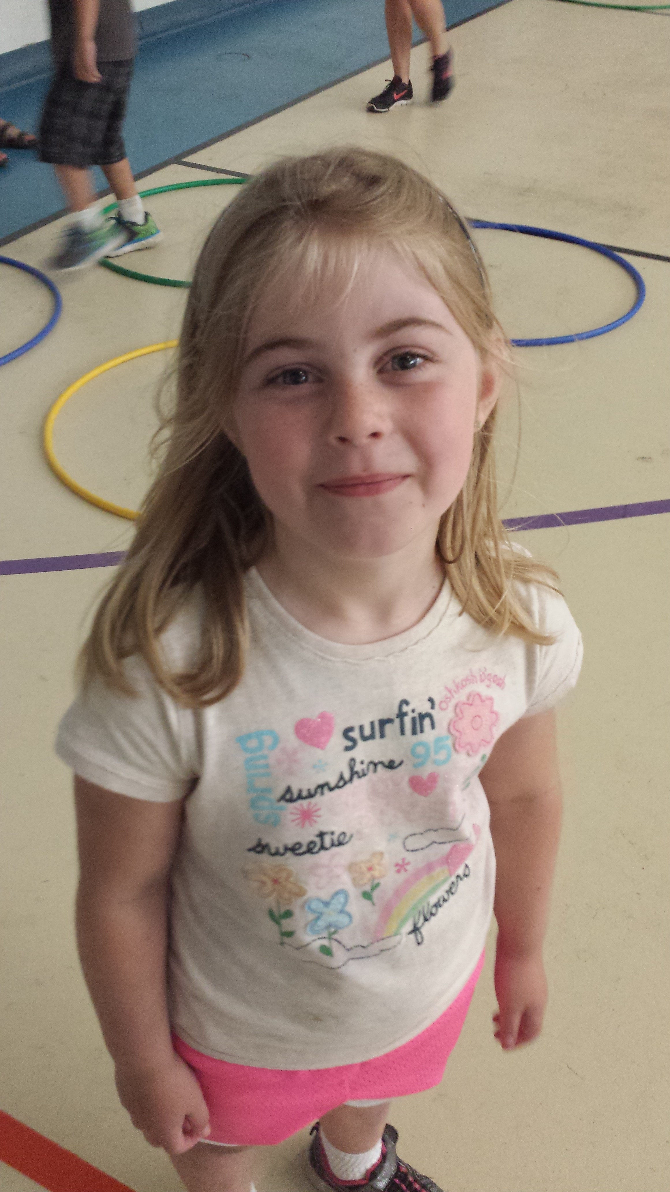 A child smiling in the gym
