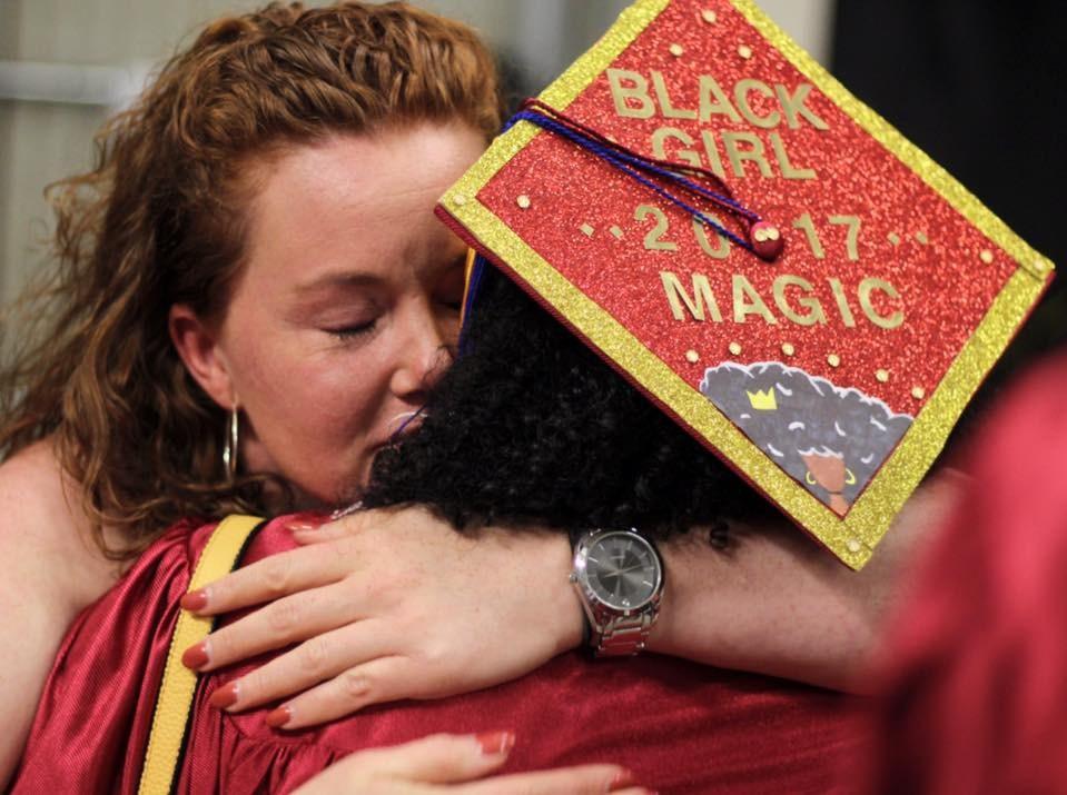 Ms. McPherson and graduate hugging