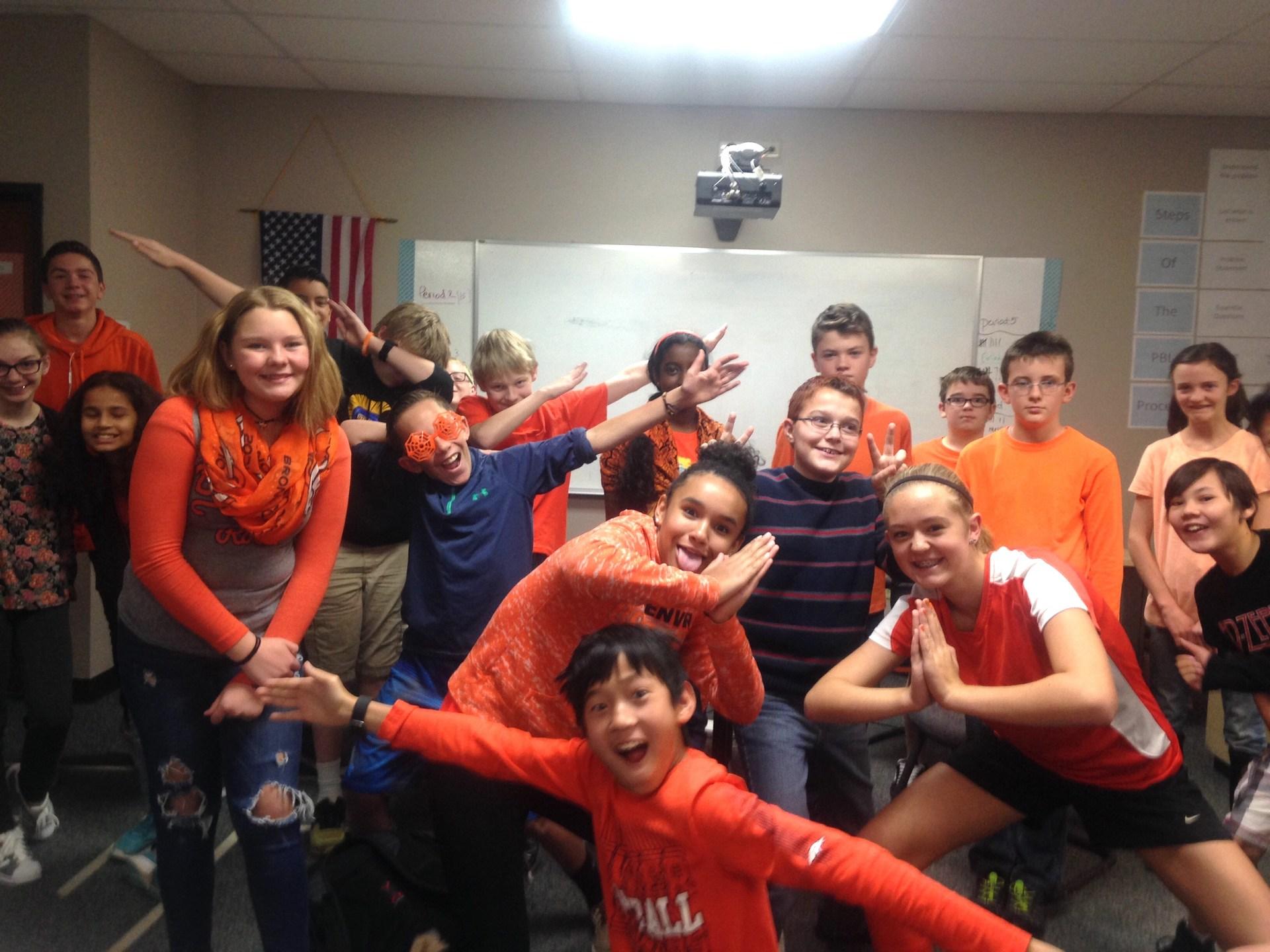 middle school students wearing orange