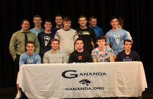 Evan Smith poses with teammates and friends during the celebratory signing on Tuesday, May 8