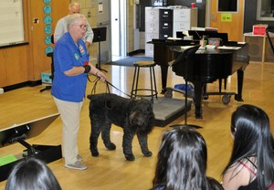 Elaine Jeche and Gunny describe the soothing effects of therapy dogs during an Oct. 23 visit to Sierra Vista High School's National Alliance on Mental Illness (NAMI) Club.
