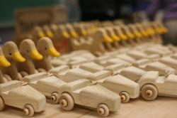 Wooden toys made included rolling ducks, small cars, locomotive engines, thumb-wrestling games, and puzzles.