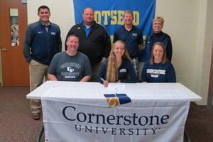 Brenna, her parents and coaches join her for the signing event.
