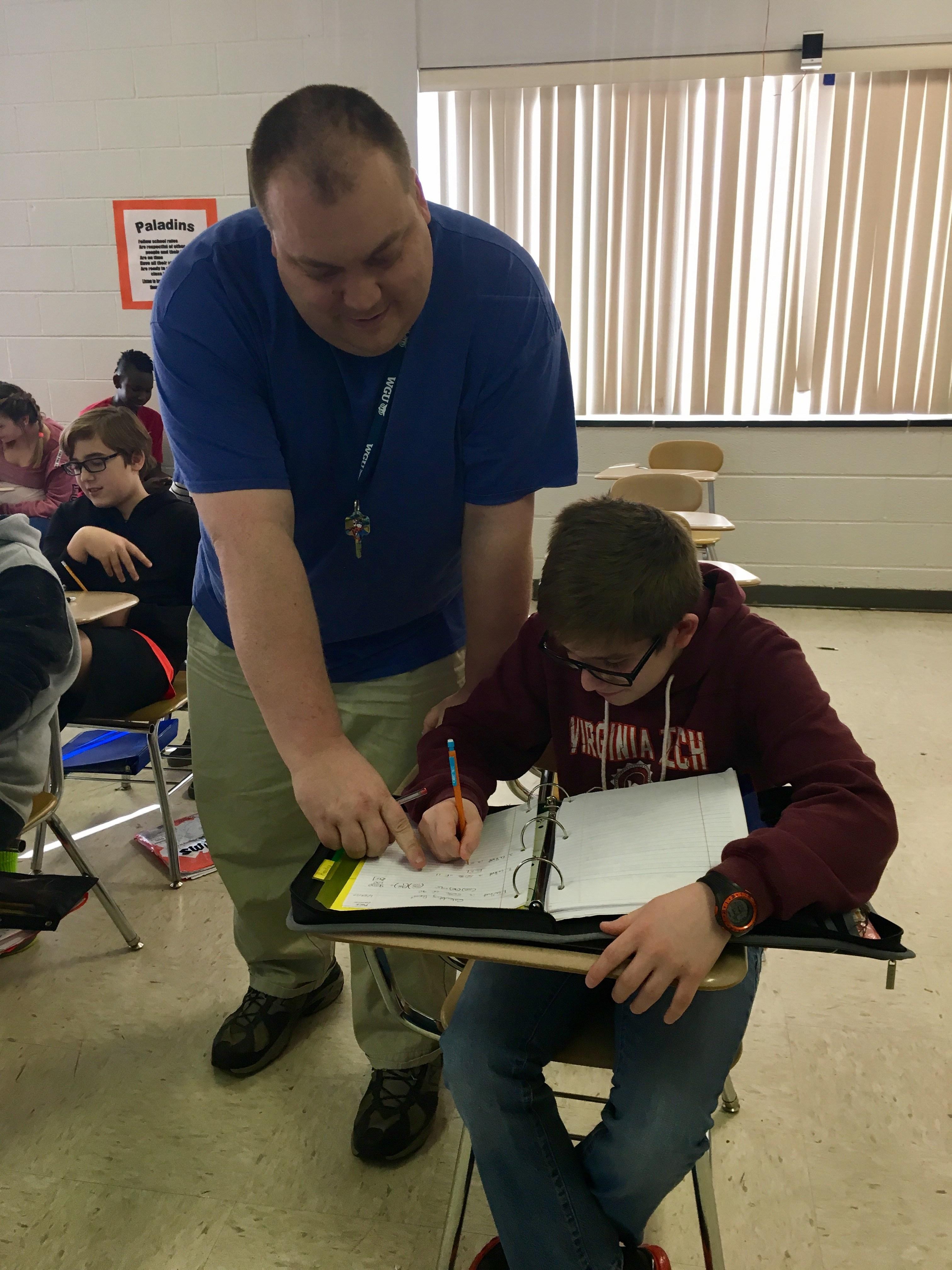 Beginning Teacher helps student