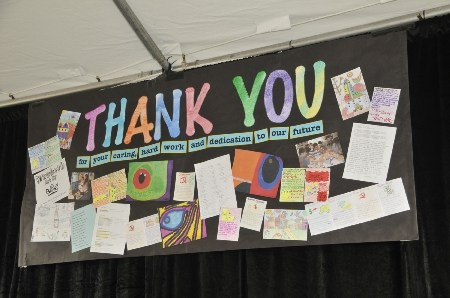 Thank You banner made by Burton Tech Students. Displaying art work as well as written statements from the students.