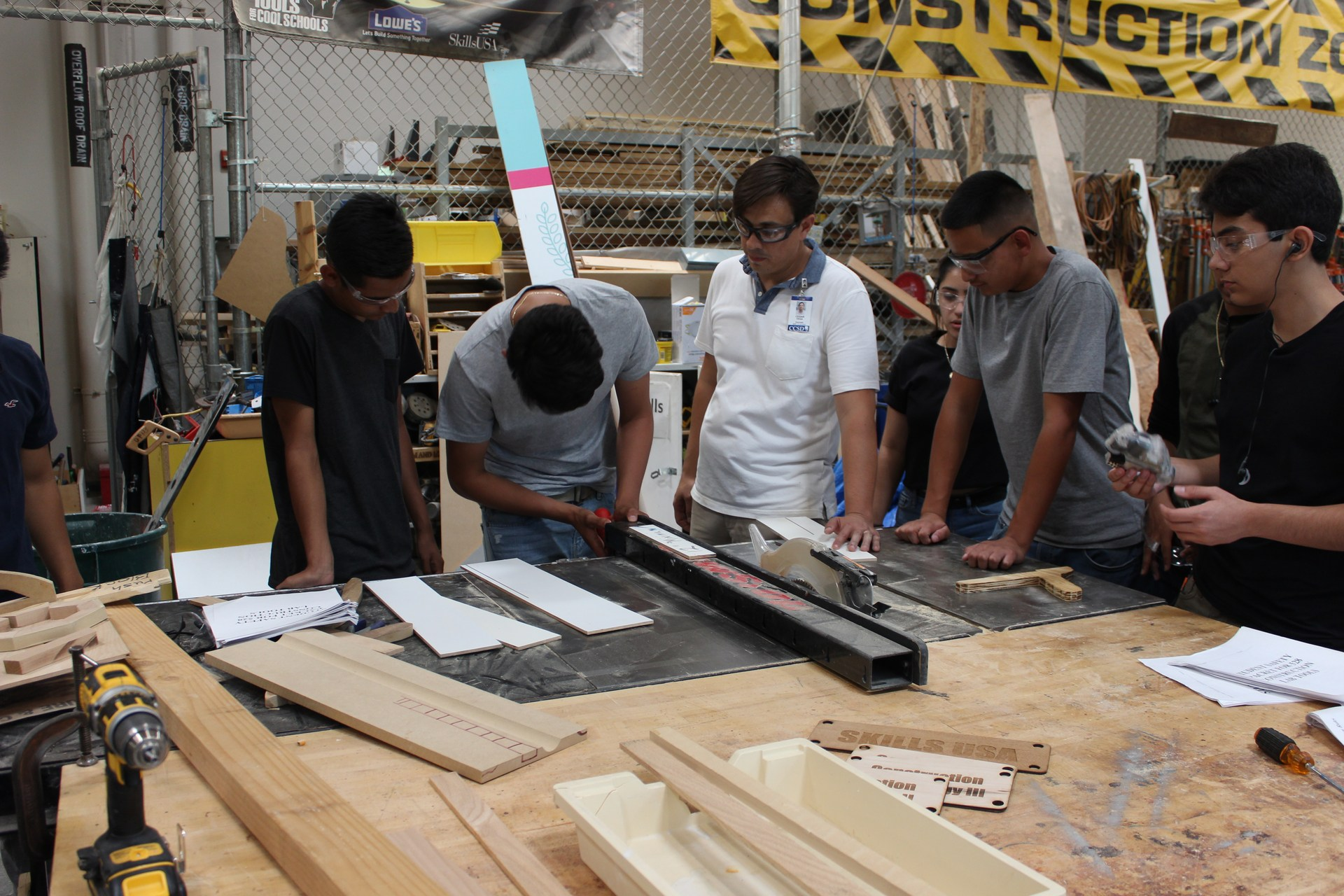 Students using the saw