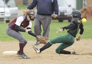 Coloma's Megan Koenigshof beats the throw to Watervliet's Celina Klimkiewicz at second base during the first game of Thursday's doubleheader.