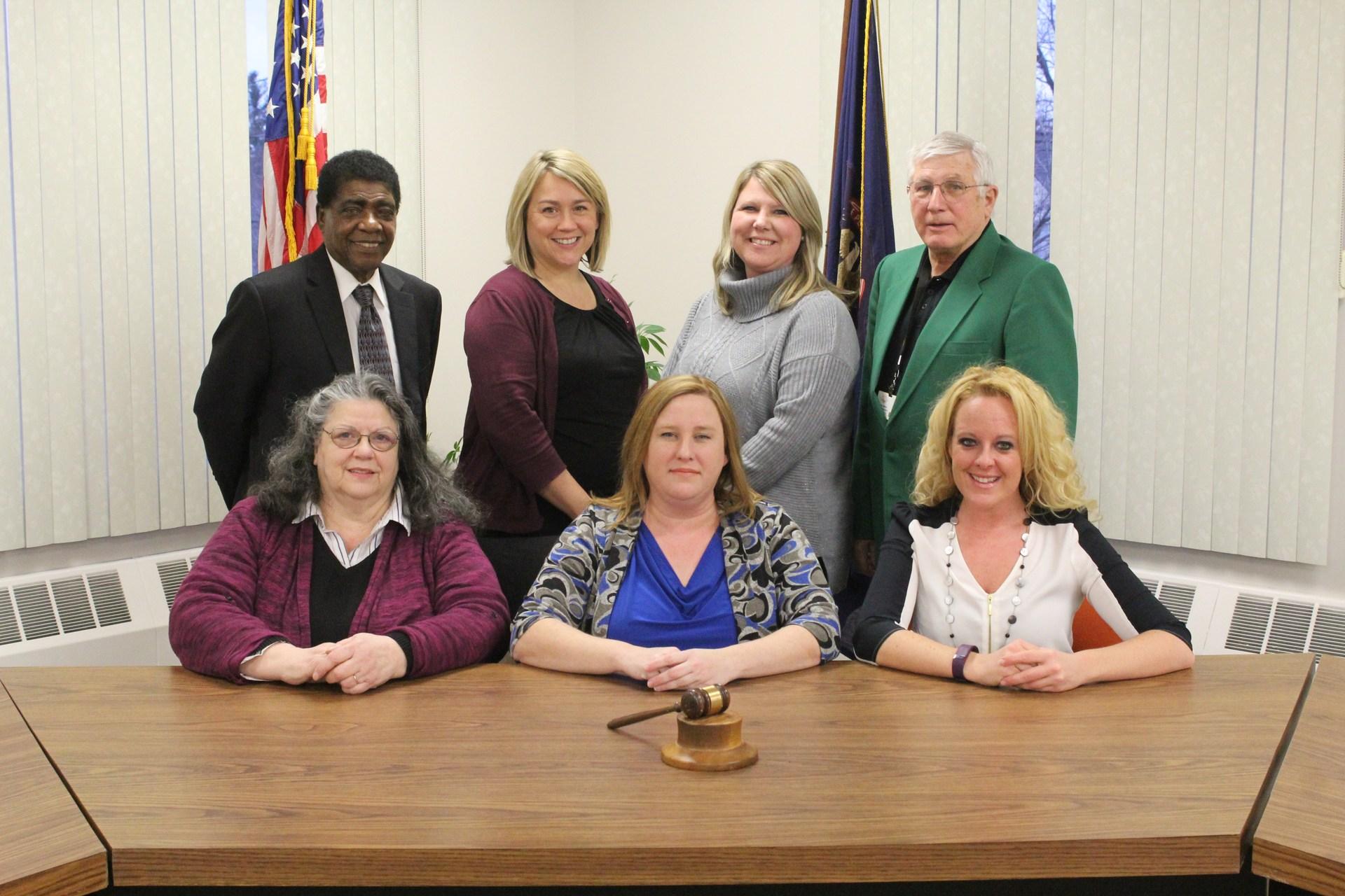 Formal posed photo of 2017-2018 Board of Education including HENRY HATTER, trustee; CARRIE SEKELSKY, Treasurer;  REBECCA AARON, Trustee; ROBERT GAFFNEY, Trustee; MARY ANN DIPZINSKI, Vice President; DENISE FRAPPIER, President;  LYDIA HEINE, Secretary