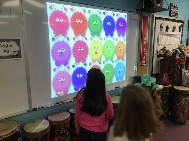 1st graders working with the interactive projector