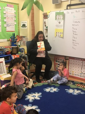 superintendent reading to the children