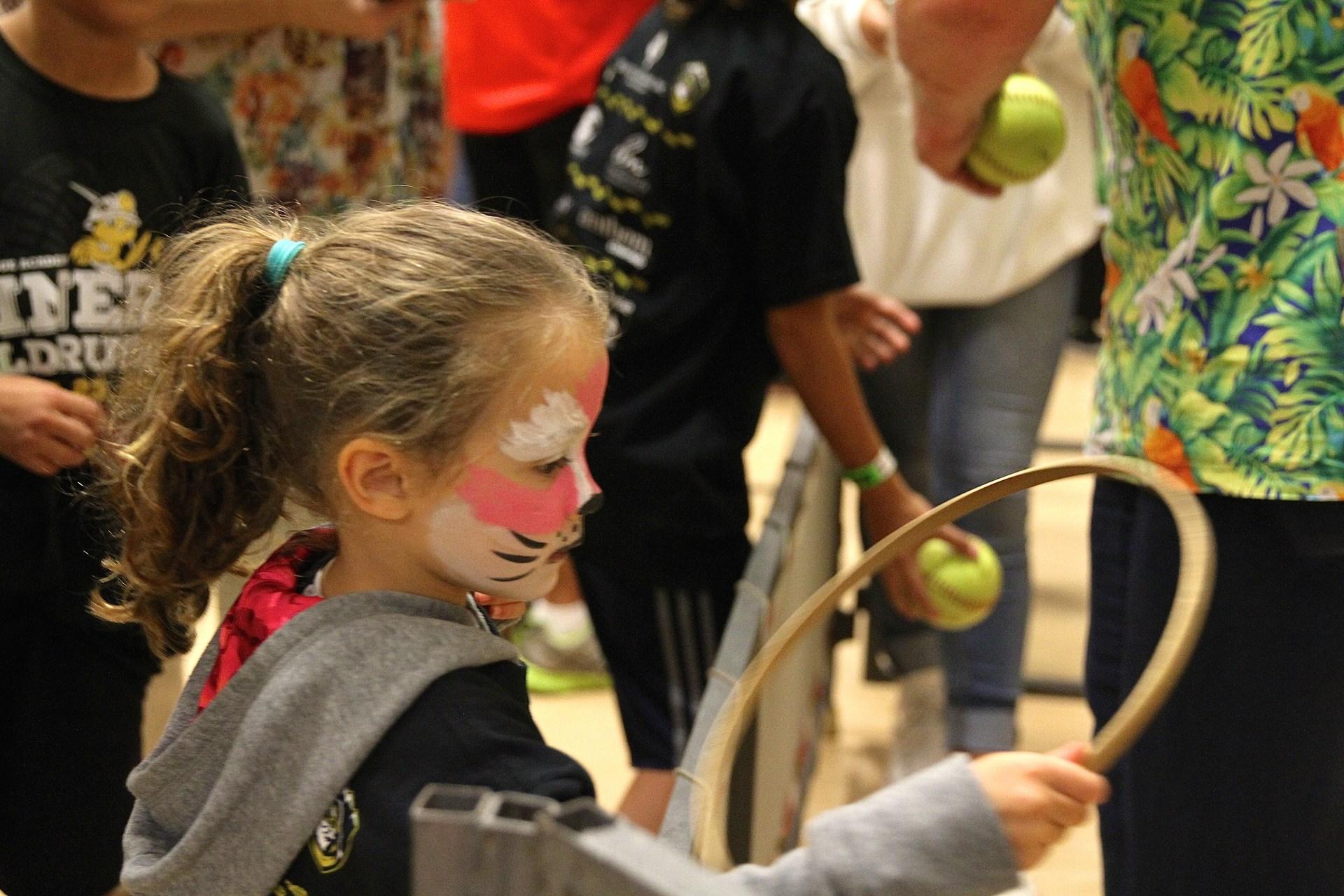 Kid playing carnival game