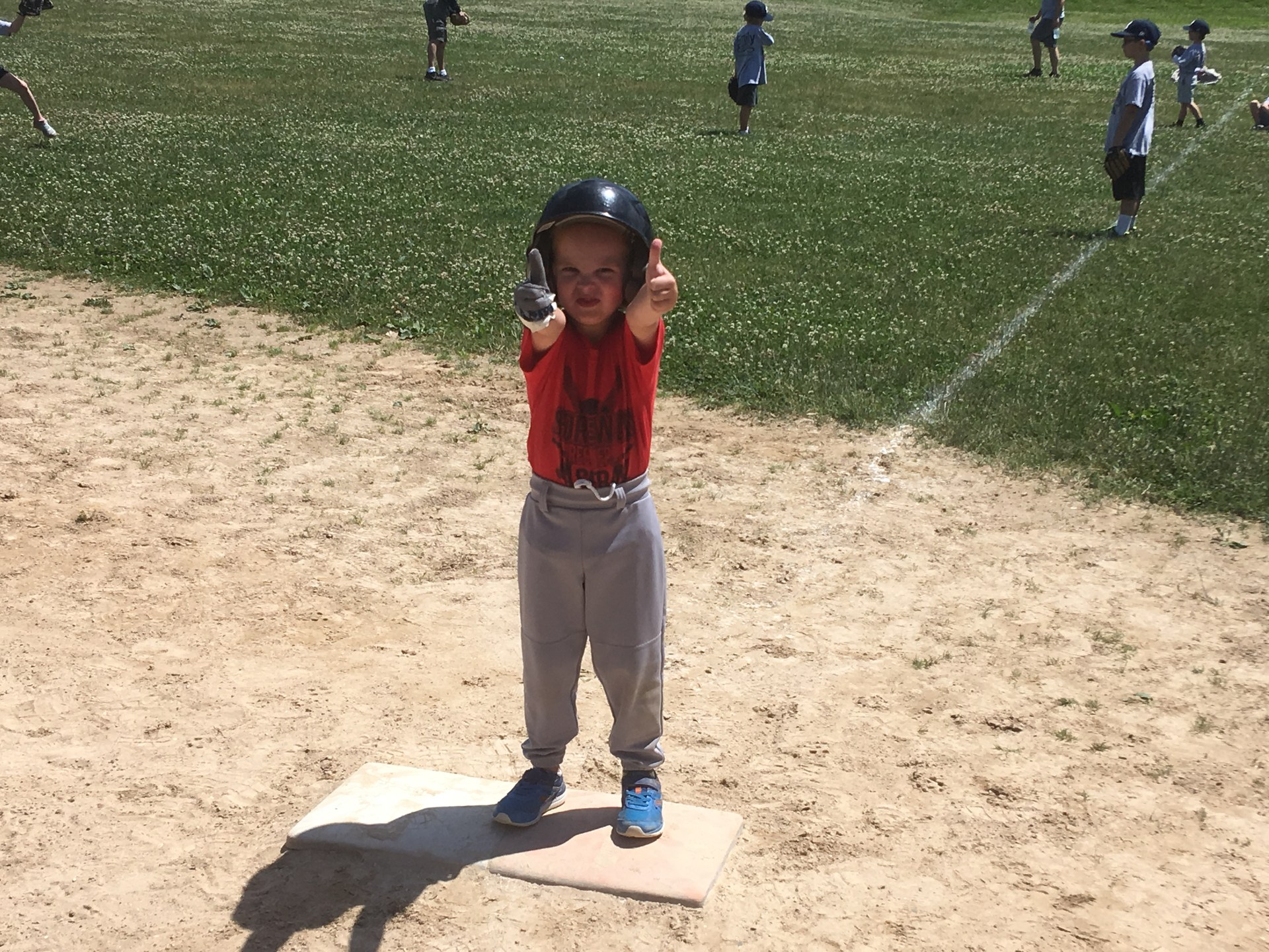 T-Ball player giving thumbs up