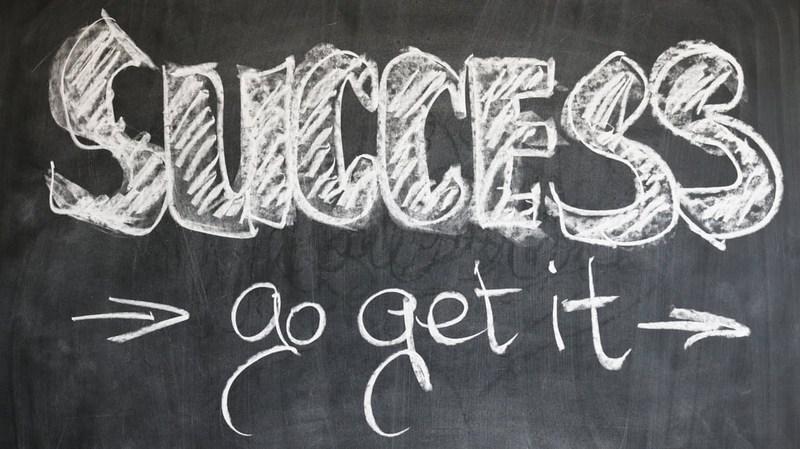 Success written on a chalkboard.