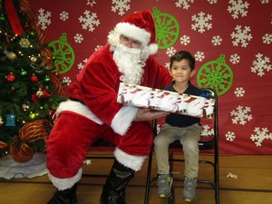Santa giving a boy a gift