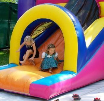 Campers on play slide.