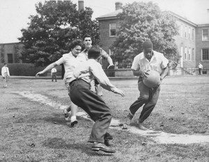 2 soldiers playing running the bases.