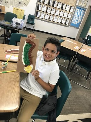 a students shows off his salt map of California
