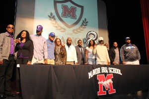 HS football players sign their letters of intent to play college ball.