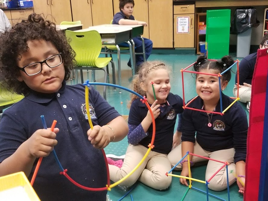children using building sticks to create shapes