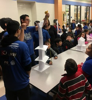 Picture showing VMHS and Mims students working on a paper tower project