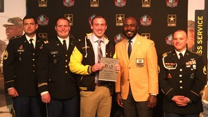 BHS senior Ryan Crowley being honored by the U.S. Army and Marshall Faulk.