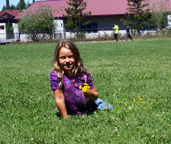 Student in Grass