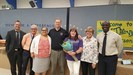 Machae Tessier announced as EWCSD Teacher of the Year with Marc Patterson, Rick Holash, Gabriela Tavitian, Tim Strand, Mary Branca, and Douglas Staine