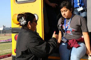 Pictured is Araceli Hernandez from the transportation department assisting Sophia Iglesias from Mims Elementary.