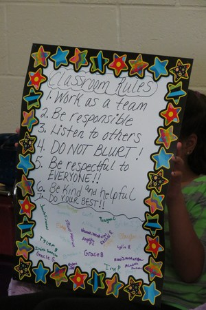 A close up of the class's social contract where all the students signed it.