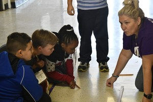 Alvarado Elementary North second grade teacher Donna Kirkland and students work on seeing how far a student jumped.