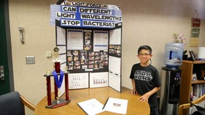 Zubin Carvalho, Bautista Creek student, in front of his science fair project