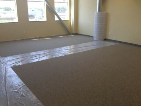 Classroom with new carpet and a path of plastic sheeting to protect the carpet