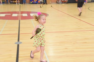 Little girl running with spatula.