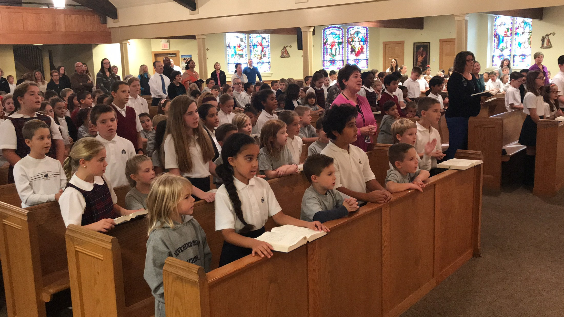 Students pray during mass