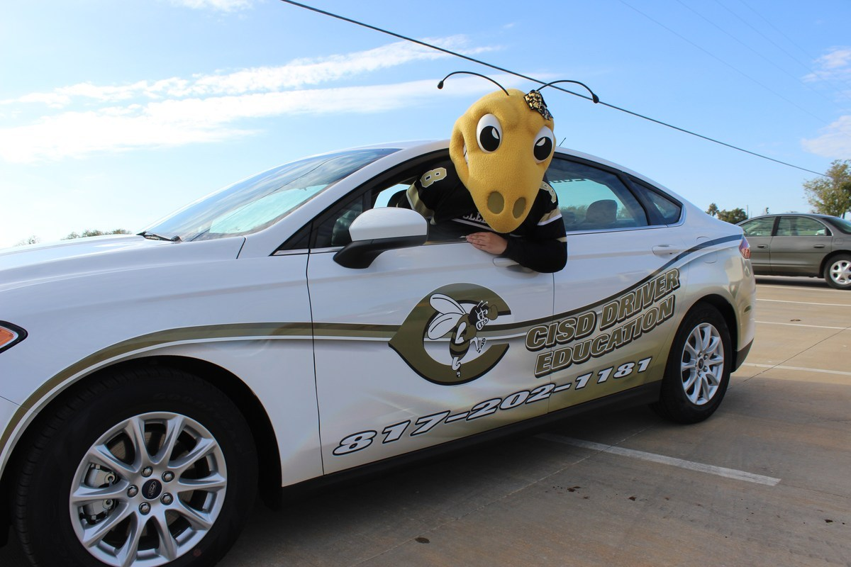 Mascot in a Cleburne ISD car