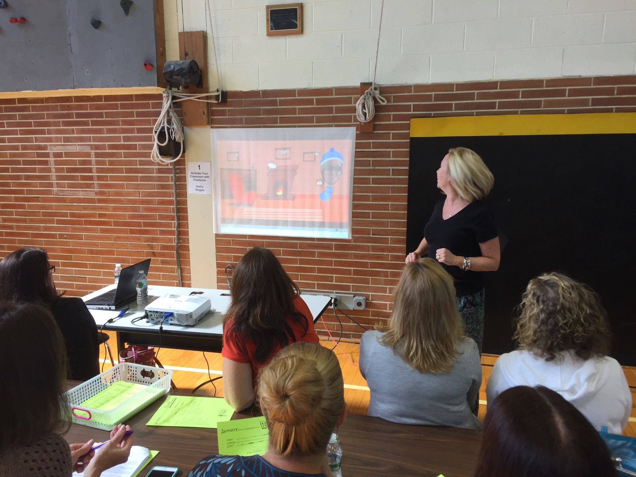 Timberlane Middle School teacher Kathy Neggia demonstrates how technology can enhance classroom instruction to a group of teachers