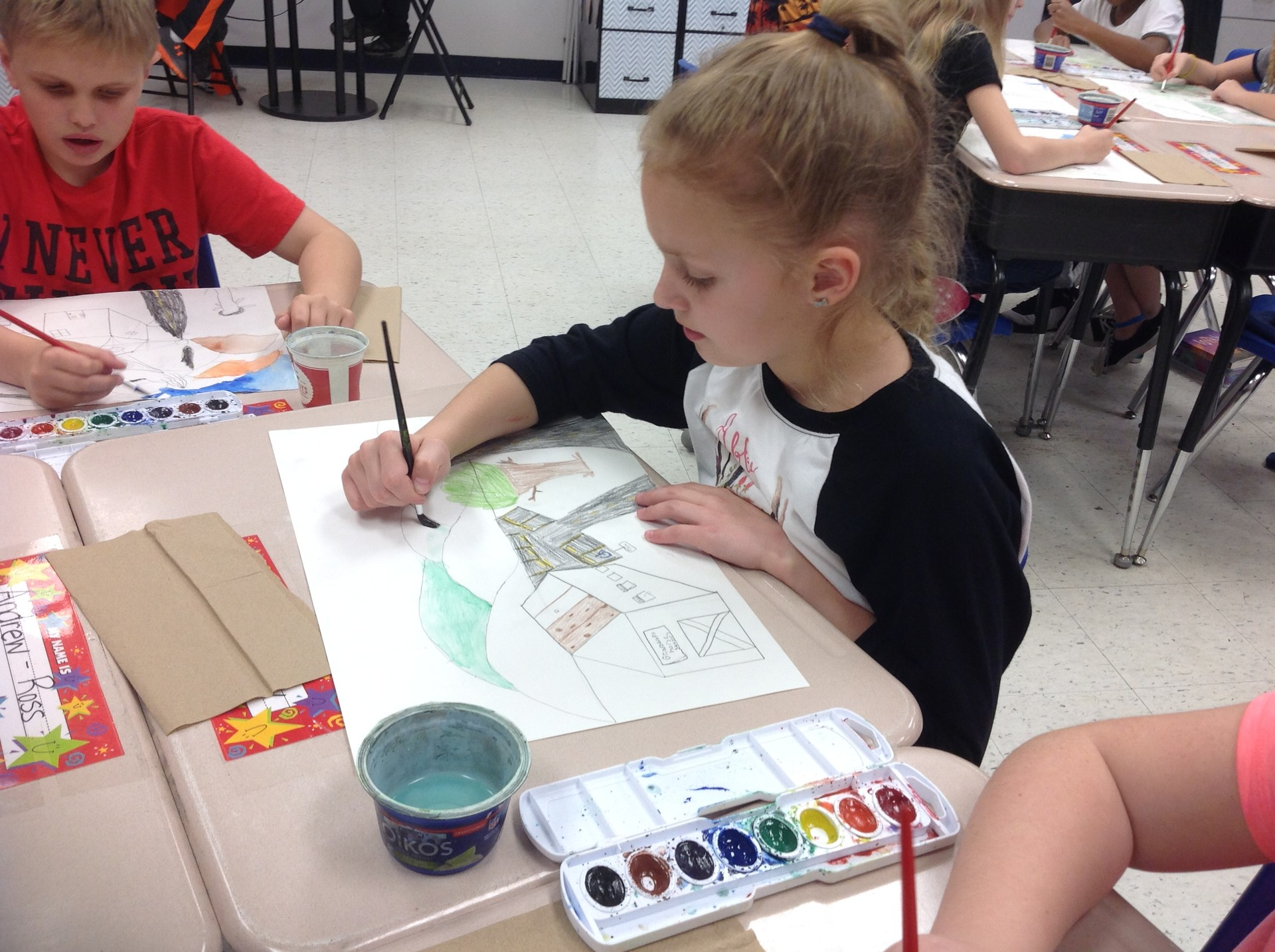 Abby working hard on her painting.